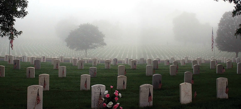 National Cemetery headstones with fog