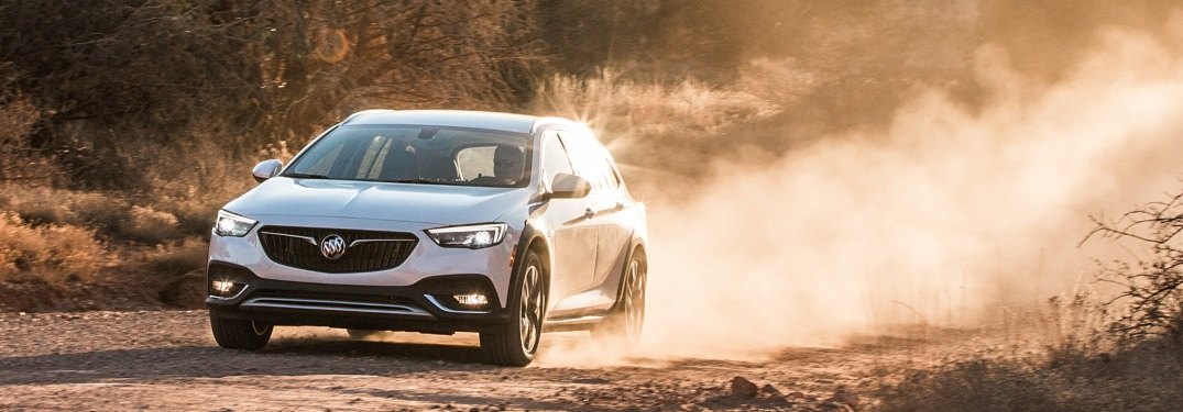 2018 Buick Regal TourX white side view AWD on a desert trail