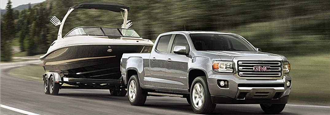 2018 GMC Canyon silver towing a boat side view