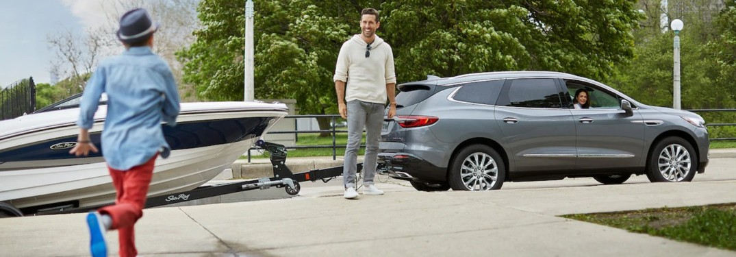 2019 Buick Enclave gray towing a boat side view
