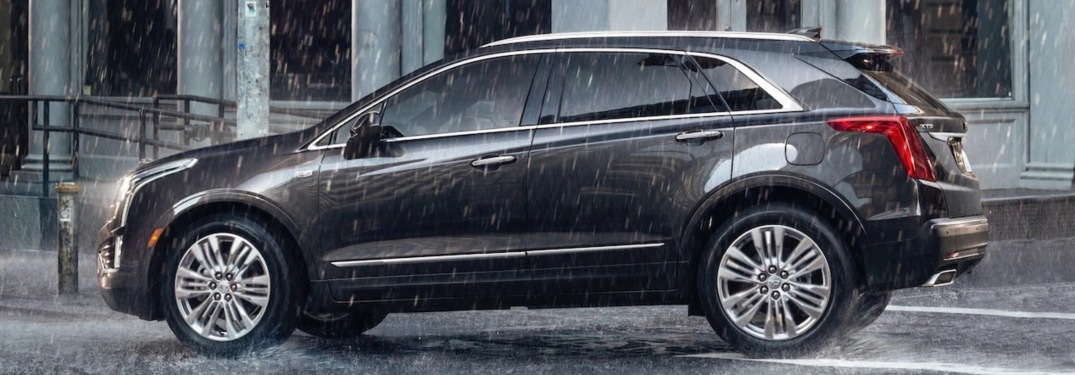 2019 Cadillac XT5 black side view in the rain