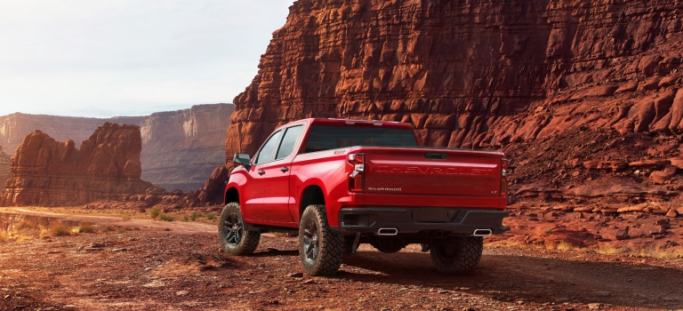 2019 Chevy Silverado red back view in the desert
