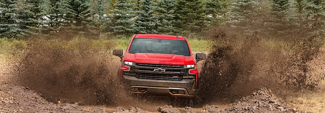 2019 Chevy Silverado red front view in the mud