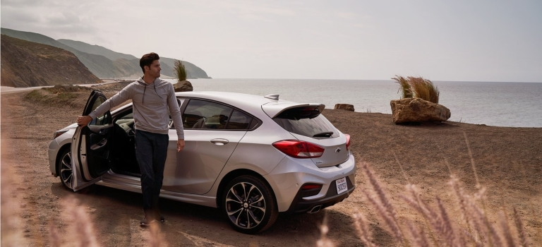 2019 Chevy Cruze RS hatchback silver side view at the beach