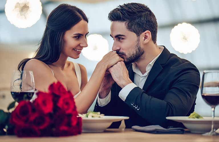Couple being romantic over a meal