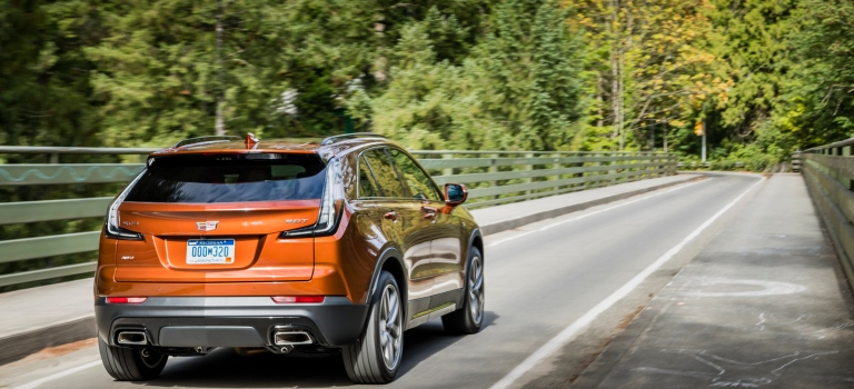 2019 Cadillac XT4 orange back view on the road