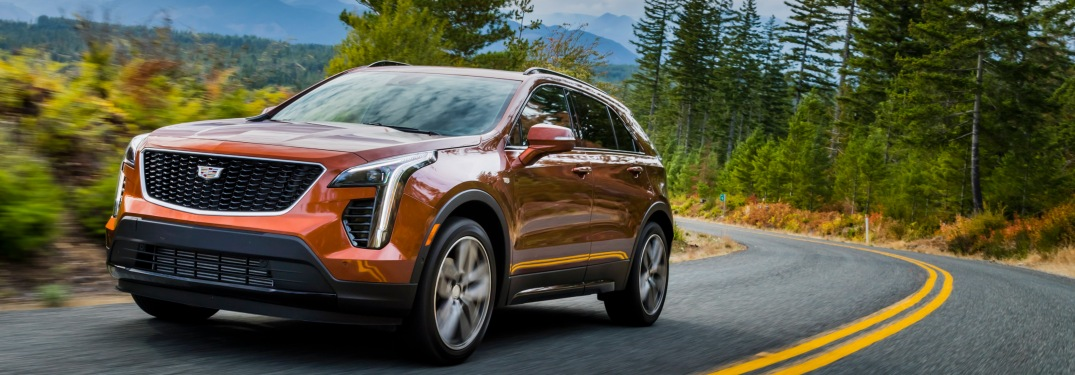 2019 Cadillac XT4 orange front view on the road
