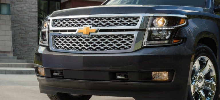 2019 Chevy Suburban black with chrome grille closeup