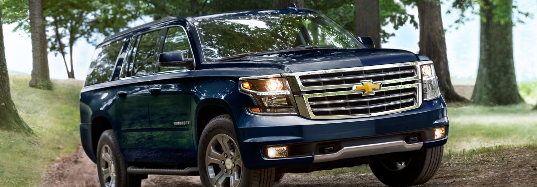 2019 Chevy Suburban blue front side view in mud