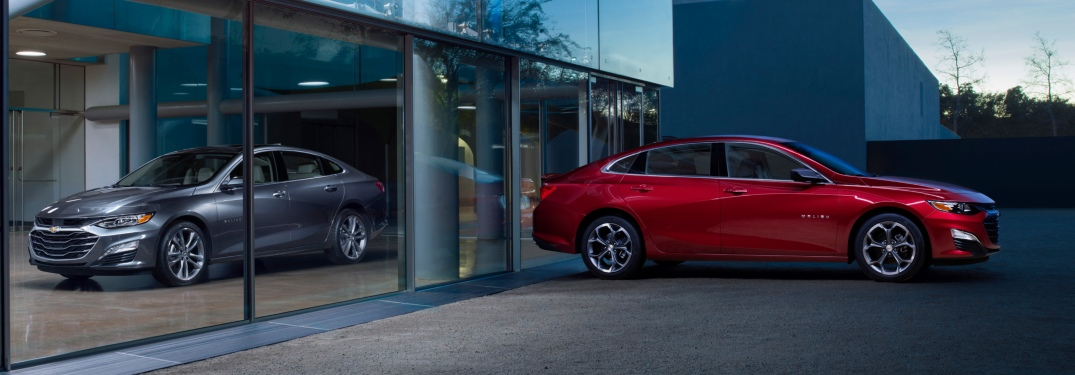 2019 Chevy Malibu models side view in red and silver