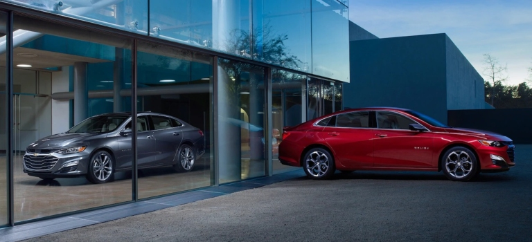 2019 Chevy Malibu red and silver side view