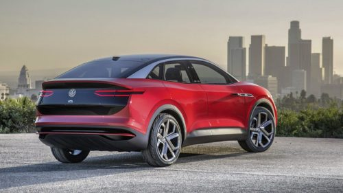 Rear profile of the Volkswagen I.D. CROZZ concept overlooking a city