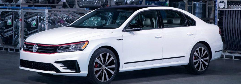2018 Volkswagen Passat GT parked by metal shelves