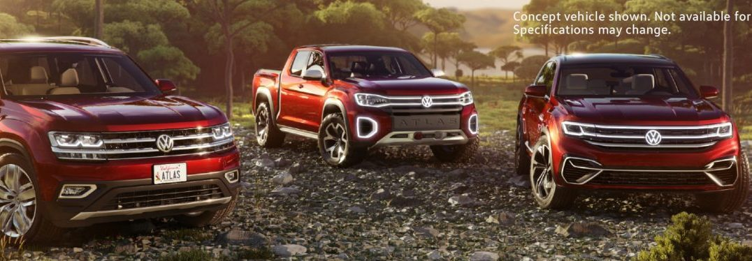 2018 Volkswagen Atlas, Volkswagen Atlas Tanoak, and Volkswagen Atlas Cross Sport models parked on a grassy area