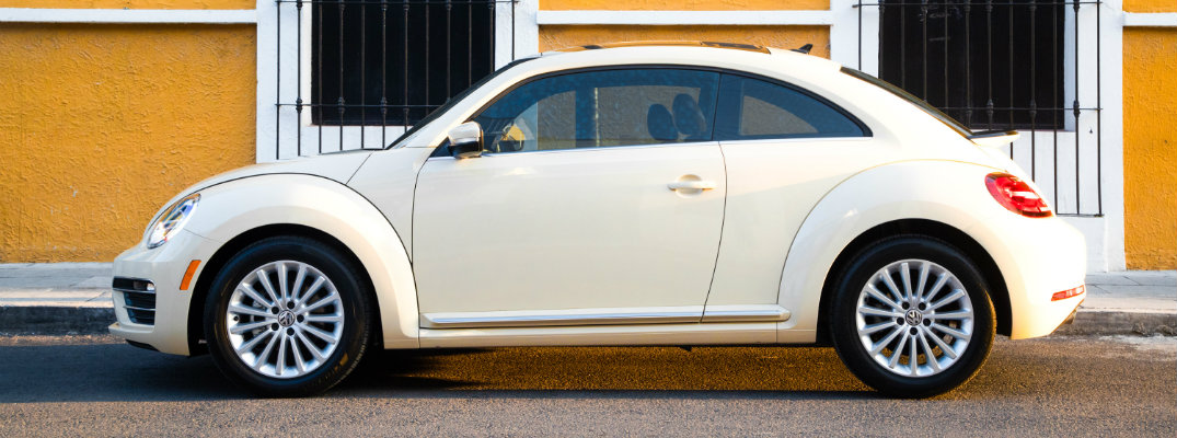 Side profile of a white 2019 Volkswagen Beetle