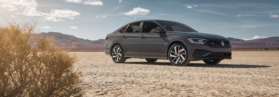 2019 VW Jetta GLI in a desert with tumbleweed in the foreground