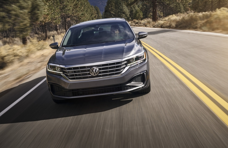 exterior front view of 2020 VW Passat driving on highway