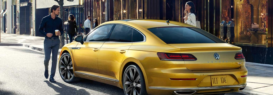 2019 Volkswagen Arteon yellow back view near people