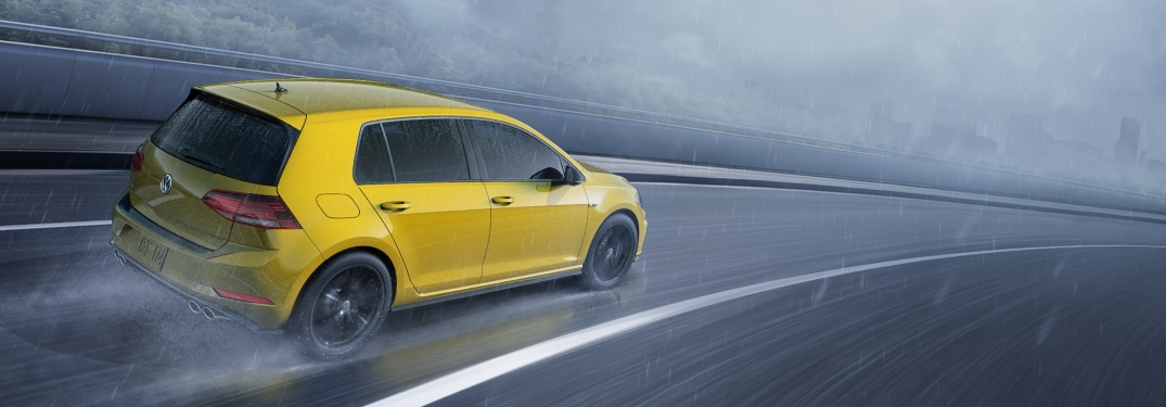 2019 Volkswagen Golf R Ginster Yellow in rain back view