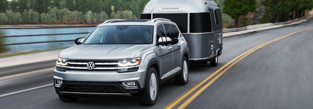 2019 Volkswagen Atlas silver front view towing a trailer