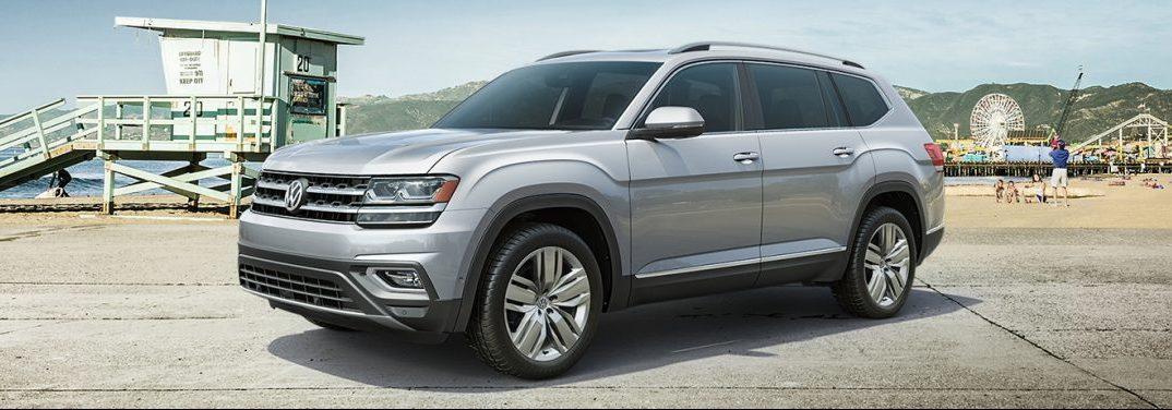 Silver 2019 Volkswagen Atlas parked near a beach.