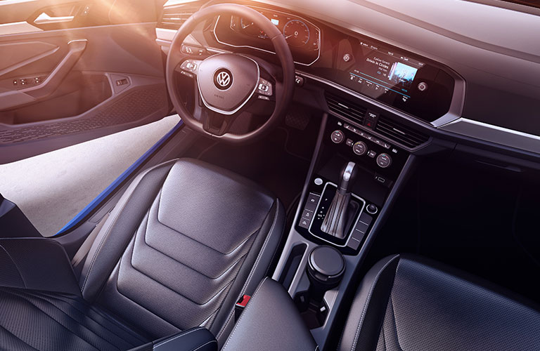Raised view of the interior of a 2019 Volkswagen Jetta, with the infotainment system plopped in the center.