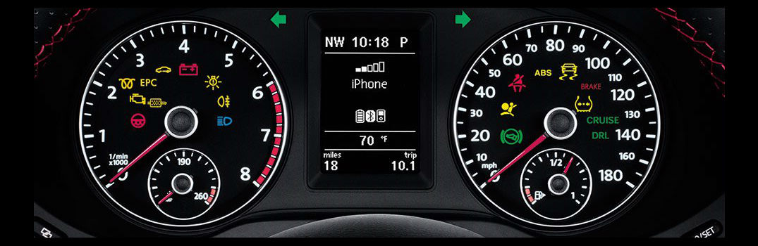 A Volkswagen dashboard with all warning lights illuminated, including the lightbulb with the exclamation point.