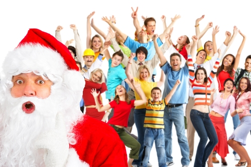 A group of people cheer happily as a shocked Santa stands in front.