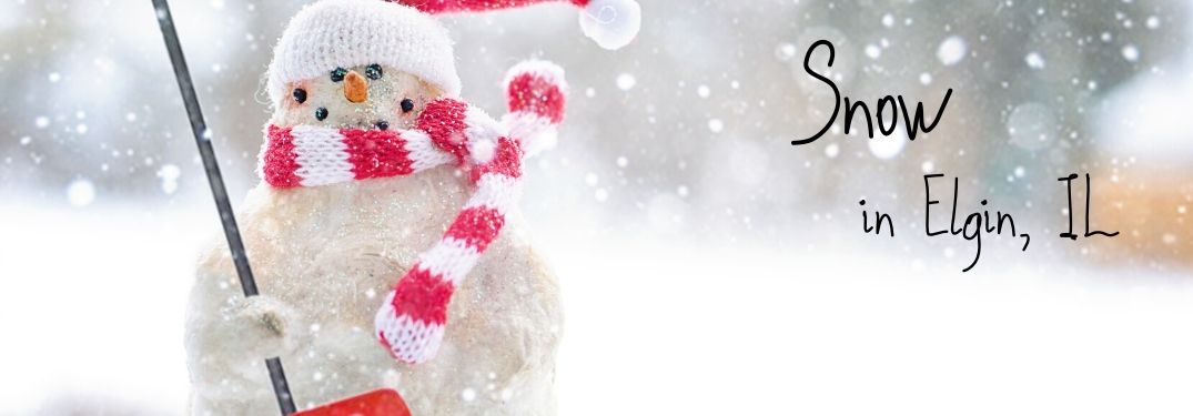 """A snowman stands with a shovel. Text beside him says, """"Snow in Elgin IL."""""""