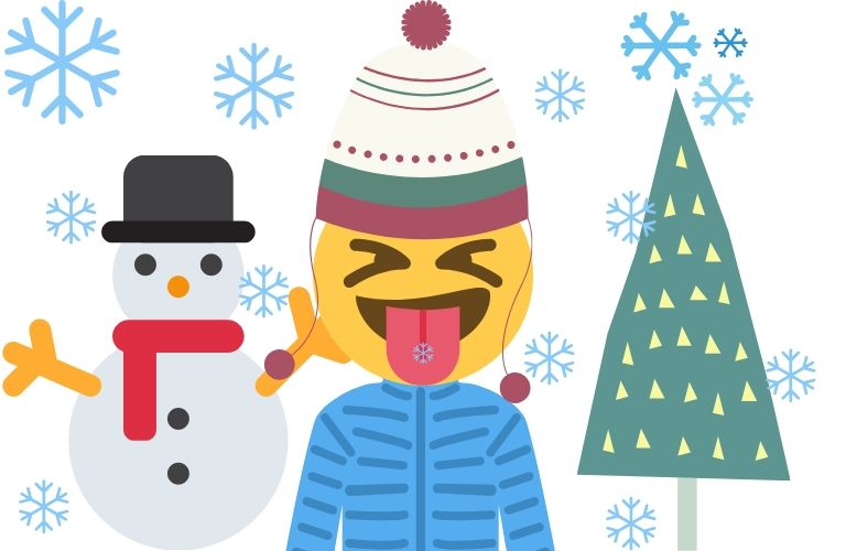 A happy kid plays and sticks their tongue out to catch a snowflake on it.