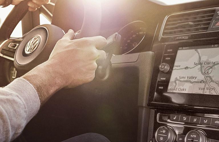 Hands grip the wheel of a 2019 Volkswagen Golf GTI.