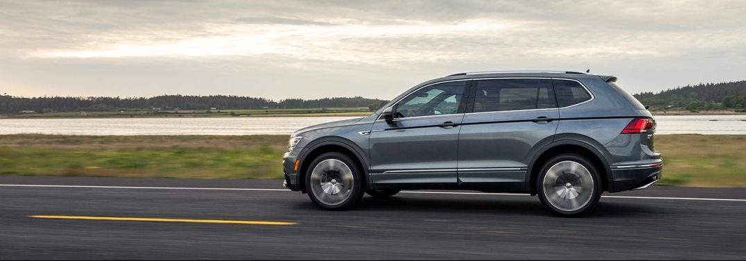 Side view of a 2020 Volkswagen Tiguan driving through the Irish countryside.