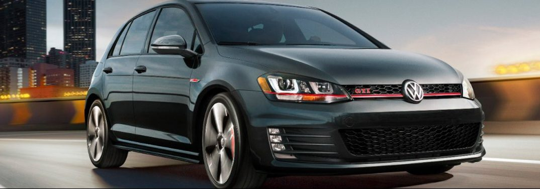 2017 Volkswagen Golf GTI rolls up a highway.