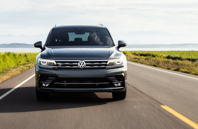 Head-on view of a 2020 Volkswagen Tiguan driving up a highway