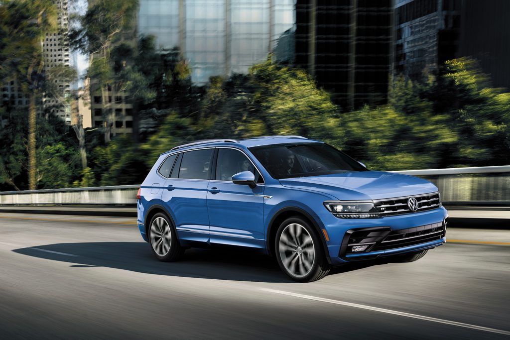 2020 VW Tiguan drives up a city highway