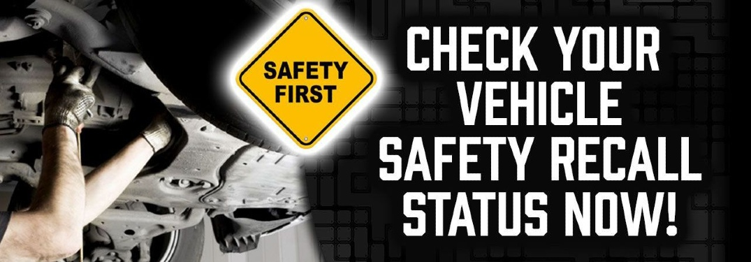 "Two human arms work on the underside of the vehicle. A yield sign reads, ""Safety First"". Text reads, ""CHECK YOUR VEHICLE SAFETY RECALL STATUS NOW!"""