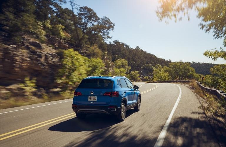 2022 Volkswagen Taos drives along a highway
