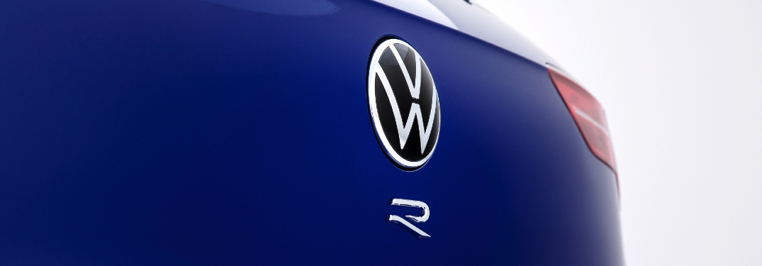 "Close-up on the ""R"" on the back of a 2022 VW Golf R"