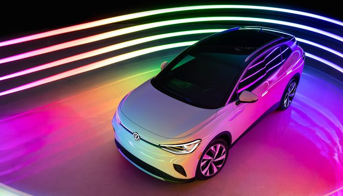 2021 Volkswagen ID.4 parked on a rainbow-colored platform