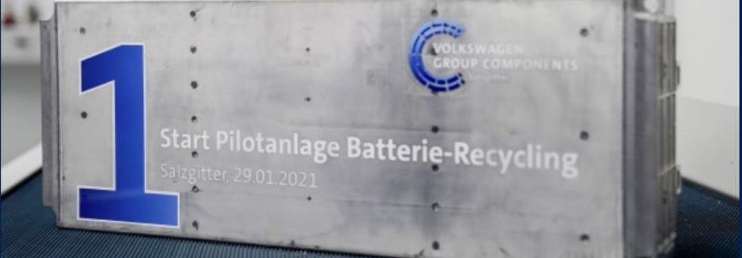 A plaque stating when the EV battery pilot recycling program started and who is running it