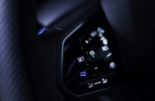 2022 VW Golf R interior close up of steering wheel mounted controls