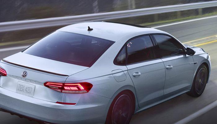 2021 Volkswagen Passat driving down a rural road