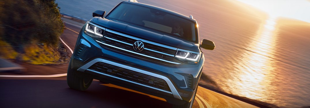 2021 Volkswagen Atlas driving down a curving road at sunset