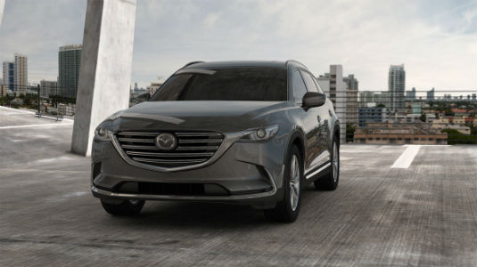 2018 Mazda CX-9 parked with a city background
