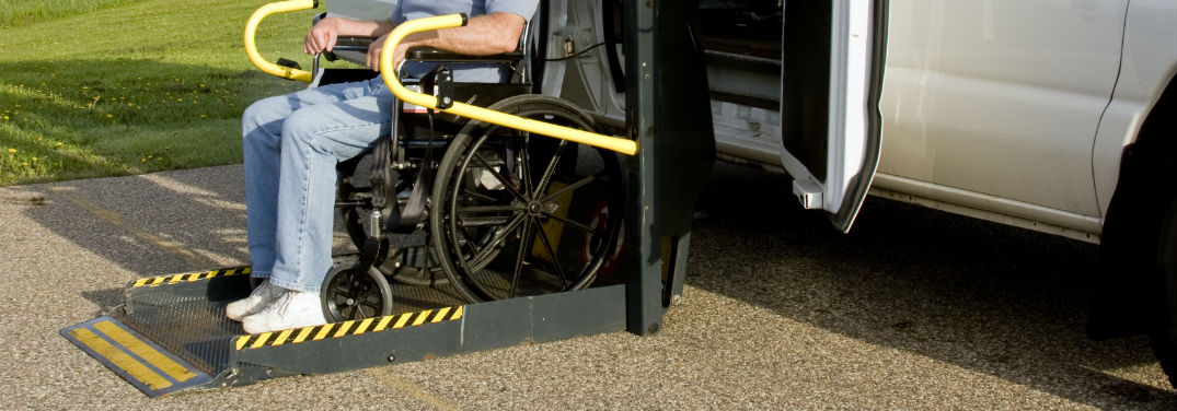 Mazda Mobility Program Cash Bonus with image of a person using a wheelchair lift on a van
