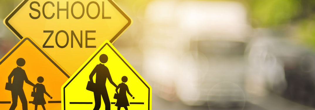 School Zone Driving Laws in North Carolina with image of school zone signs