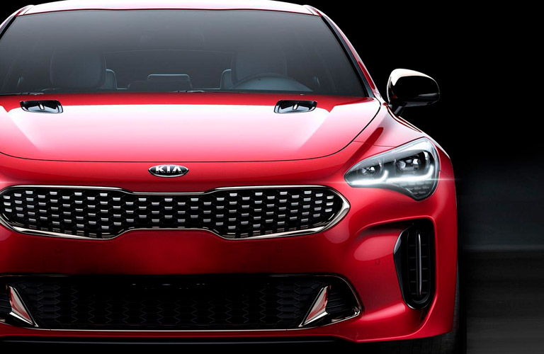 Front View of Red 2018 Kia Stinger in Front of Black Background