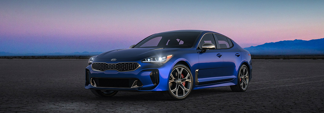 Blue 2018 Kia Stinger Parked on a Dry Lake Bed