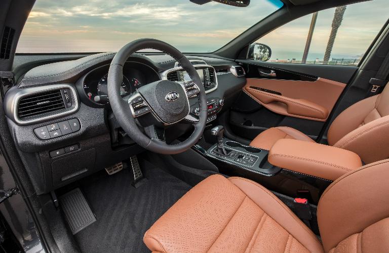 Dashboard and Brown Front Seats of 2019 Kia Sorento