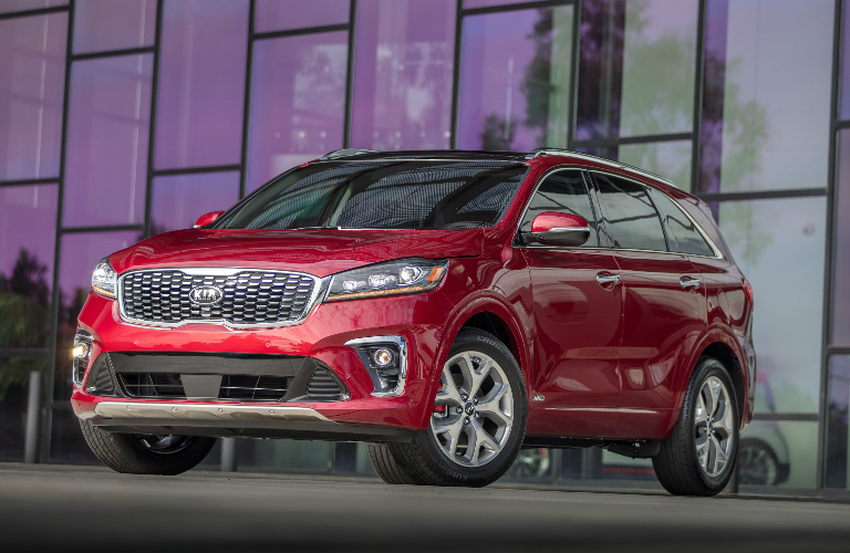 Red 2019 Kia Sorento Parked in Front of a Large Building